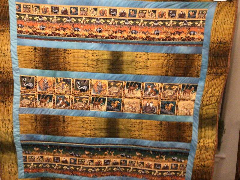 CQ Bev Piper strip quilt